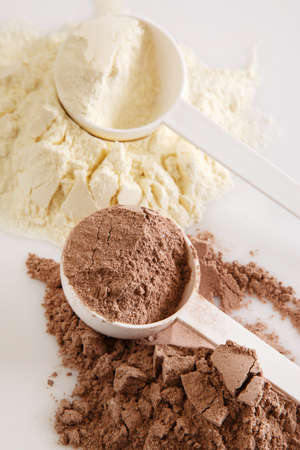 Close up of protein powder and scoops photo