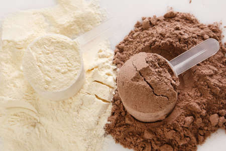 Close up of protein powder and scoops Stock Photo - 34971327