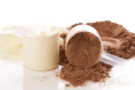 Close up of protein powder and scoops Archivio Fotografico