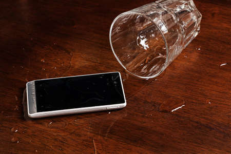overturn: Smartphone in water on the table