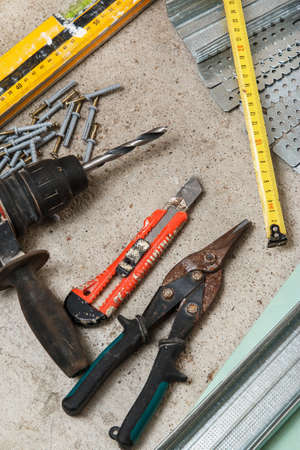 Different instruments and materials for build a plasterboard walls