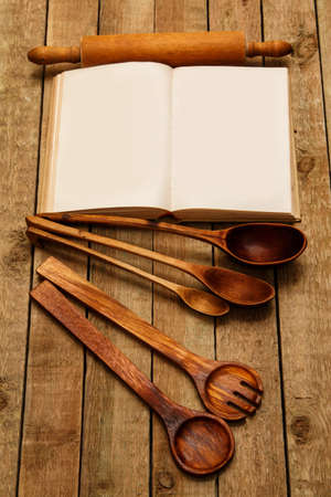 cooking utensils: Wooden kitchen utensils on the table Stock Photo