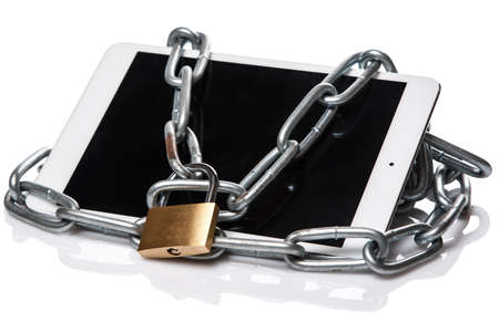 Tablet pc and padlock with chain over white background photo