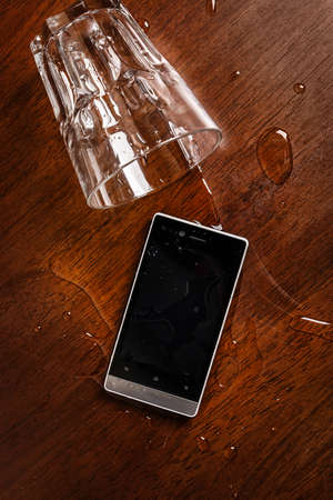 Smartphone in water on the table