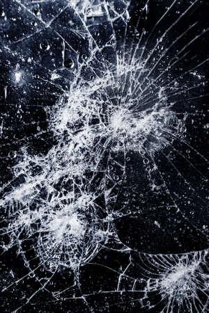 Close-up van gebarsten glazen oppervlak