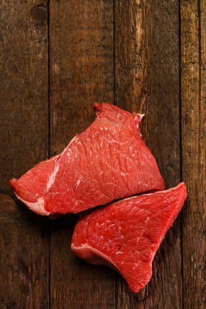 Raw meat on wooden table