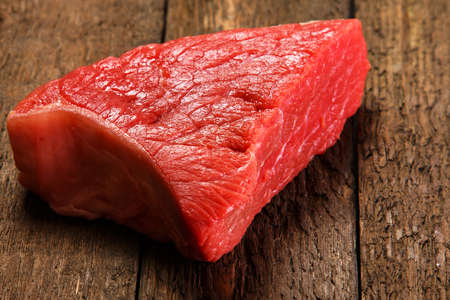 steak beef: Raw meat on wooden table