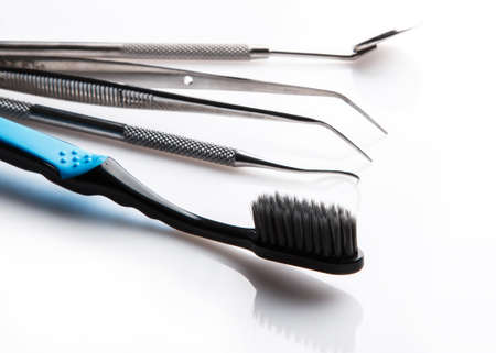 Some dental tools on white table photo