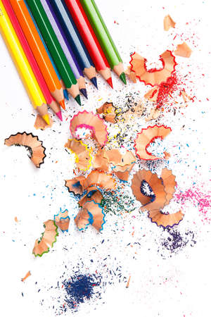 shavings: Multicolored pencils and shavings on white background Stock Photo