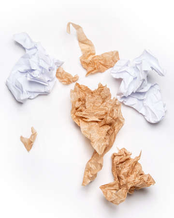 Crumpled paper on white background photo