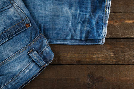 jeans pocket: Blue jeans on old wooden surface Stock Photo