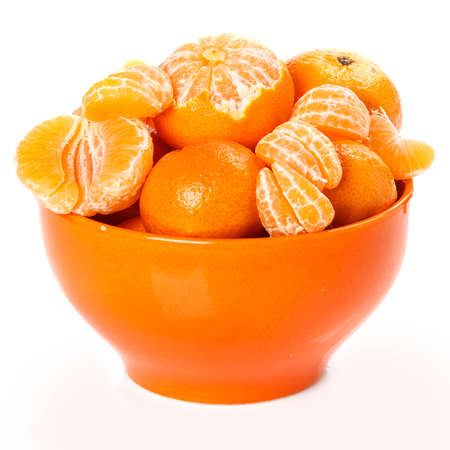 Fresh mandarins in bowl on white background photo