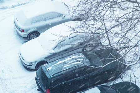 deep freeze: Cars on parking covered with snow Stock Photo
