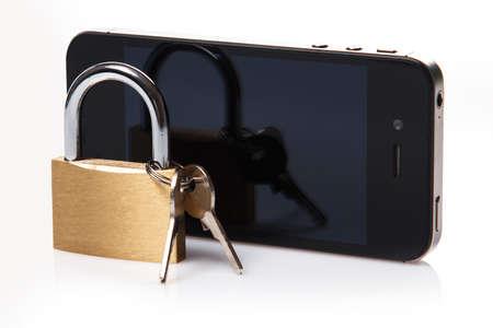 Smartphone and padlock on white background photo