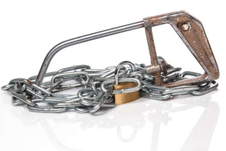 Padlock with chain and saw on white background photo