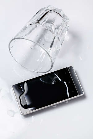 Smartphone in water on the table Stock Photo - 37066865