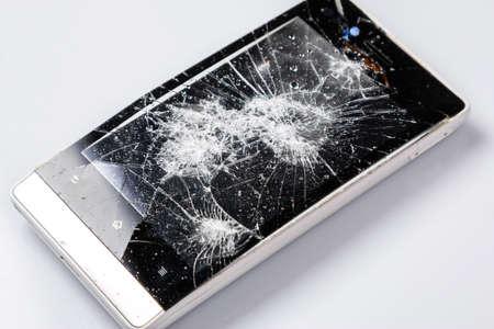 Broken smartphone with cracked display photo