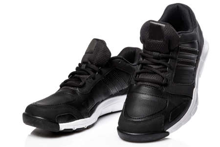 Black sport shoes on white background 스톡 콘텐츠