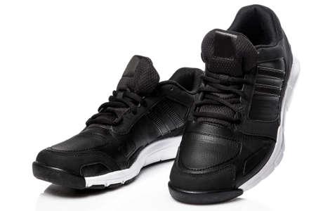 Black sport shoes on white background Foto de archivo