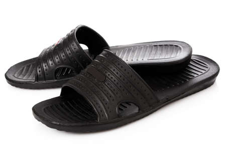swimming shoes: Black flip flops on white background