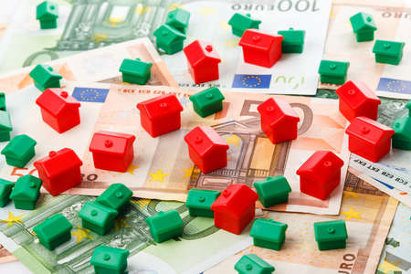 Small toy houses and euro banknotes