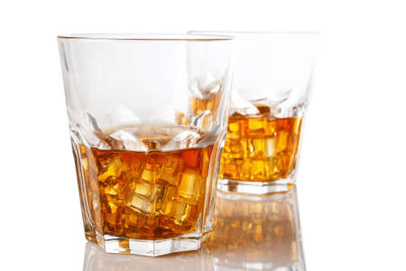 table glass: Glasses with whiskey on white background