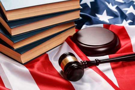 auction: Gavel and books over american flag