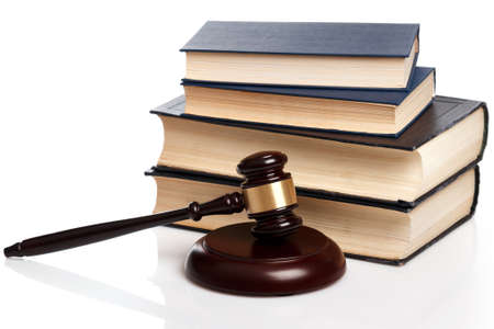 Gavel and books on white background