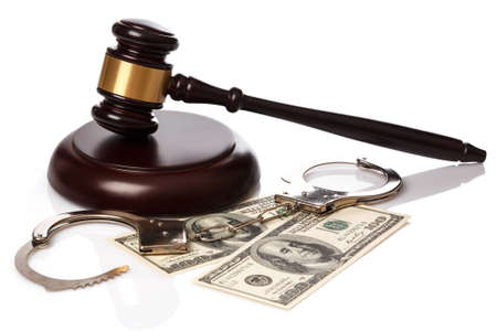 auctioning: Gavel and banknotes on white background