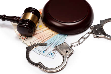 Gavel and banknotes on white background photo