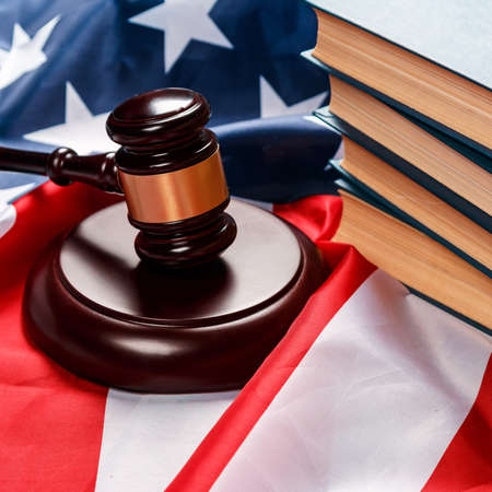 Gavel and books over american flag photo
