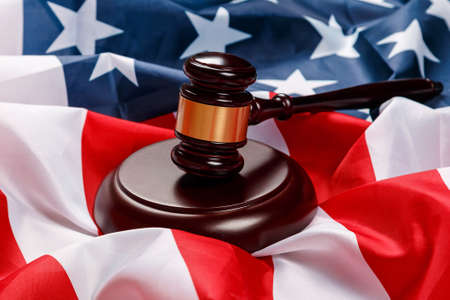 Judge gavel over american flag photo
