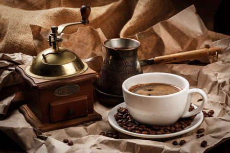 cezve: Coffee cup and cezve for turkish coffee and coffee mill Stock Photo