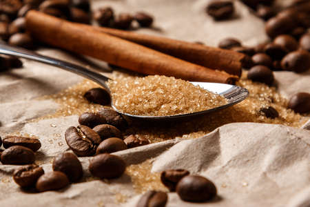 Close up of spoon with brown sugar and coffee beans photo