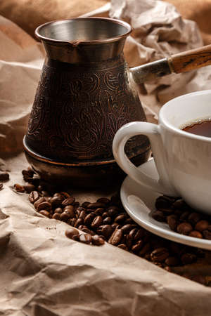 cezve: Coffee cup and cezve for turkish coffee on crumpled paper surface