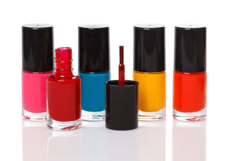 Bottles with a colorful nail polish on white background photo