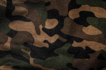 camuflaje: La textura de una tela de camuflaje Foto de archivo