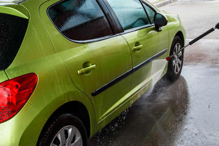 Green car in a car wash