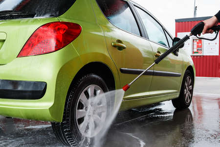 Green modern automobile in the car wash