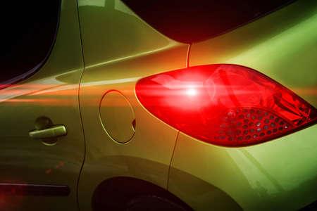 brake: Rear part of a modern green car