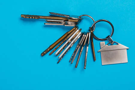Bunch of different keys on blue background