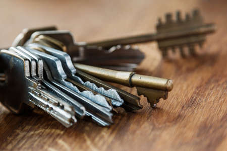 Bunch of different keys on wooden table Stock Photo - 41839888