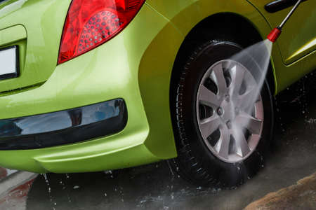 wash car: Green modern automobile in the car wash