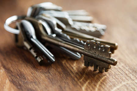 locksmith: Bunch of different keys on wooden table