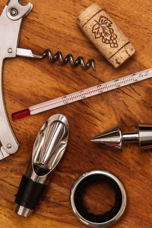 Different wine tools  on wooden surface Stock Photo