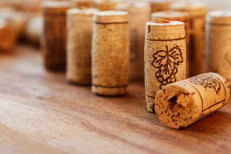 wine bottle: Different corks on wooden surface