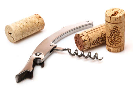 Corkscrew and corks on white background Stock Photo