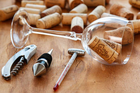twist cap: Different wine tools  on wooden surface Stock Photo