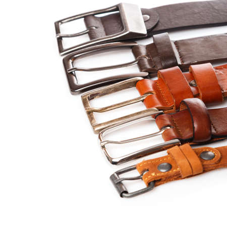 Different leather belts on white background Reklamní fotografie - 44235249