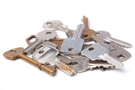 key: Bunch of different keys on white background